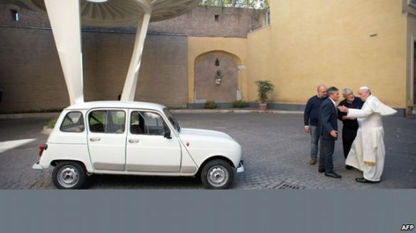 Pope Francis, right, and Father Renzo Zocca, second right, with the Renault 4. Photograph: AP